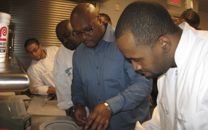 Aaron McCargo, Jr. teaches a cooking class at the Cathedral Kitchen Oct. 14.