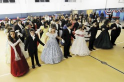 A school dance where the DJ plays 'The Tennessee Waltz'
