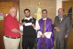 Seminarian receives check from Knights