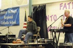 Tony Melendez sings for local students