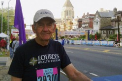 Volunteer, 80, inspires teammates in run