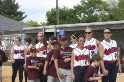 Softball players and their buddies