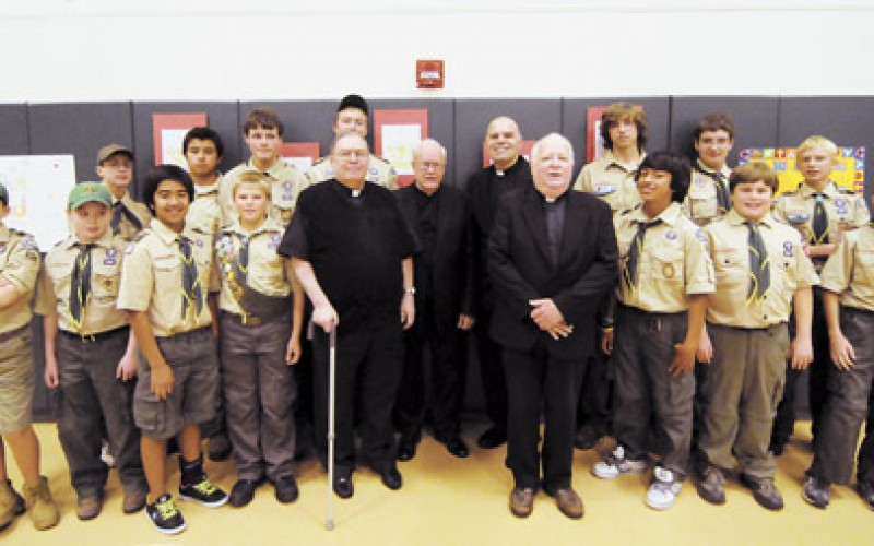 Scouts celebrate World Priest Day at Assumption