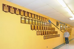 Volunteer crew creates a wall in honor of school crew teams