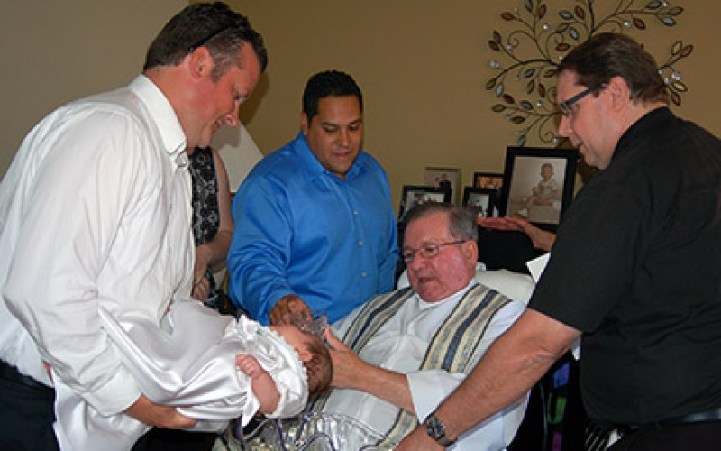 Msgr. McIntyre baptizes nieces in home ceremony