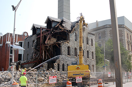 Long after the school closed, the building comes down