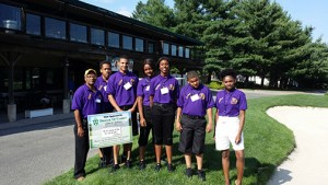 Father Gerard Marable, pastor of St. Josephine Bakhita Parish, Camden, stands with Abraham Nwaemo, Zaire Webb, Elodie Fosana, Sha'Daisha Baskerville, Matteo Webb, and Tamera Hilton at the Pennsauken Country Club golf fundraiser June 30. They were among the teenagers participating in a summer enrichment program that encouraged entrepreneurship and taught business and leadership skills.