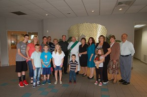 Photo by James A. McBride Msgr. Roger E. McGrath, pastor; Father Robert J. D'Imperio; and Deacon John A. Contino pose for a photo with catechists and their families at Sts. Peter and Paul Parish, Turnersville, on Sept. 21.