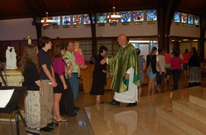 Photo by James A. McBride Father Joseph Ganiel, pastor, greets catechists at Holy Child Parish in Runnemede on Sept. 7, its observance of Catechetical Sunday.