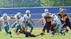 Photo by Alan M. Dumoff On Sept. 20, the Camden Catholic High School (Cherry Hill) football team could not be stopped, defeating Gloucester Catholic handily by a score of 60-6. Above, the home team Rams try to stop the Irish from moving the ball down the field.