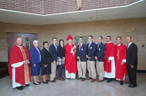 Bishop Dennis Sullivan poses for a photo with senior student government and school and diocesan administration. Pictured from left are Father Robert Hughes, Vicar General; Mary Boyle, Superintendent of Catholic Schools; Sister Marianne McCann, principal; Matthew Janis; Emma Erwin; Bishop Sullivan; Michael Bizzoco; Robert Helsel; Anthony Leone; Deacon Leo Howitz; Father John Rossi, Director of Catholic Identity; and Michael Chambers, school president. Photo by James A. McBride