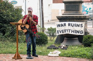 Photo by James A. McBride Musician and peace activist Tom Mullian speaks at a peace rally held at Sacred Heart Parish, Camden, on Sept. 21.