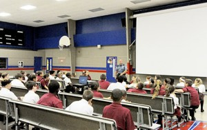 James Smith, Gloucester County EMT, who was present at Ground Zero in the aftermath of the 9/11 terrorist attacks on the World Trade Center, speaks to students at St. Michael the Archangel Regional School, Clayton. Photo by Alan M. Dumoff, ccdphotolibrary.smugmug.com