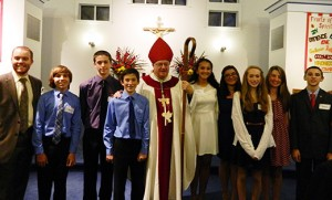 Bishop Dennis Sullivan stands with the principal and some students of Bishop McHugh Regional School following confirmation at Our Lady of the Angels Parish, Cape May Court House, on Oct. 22. Pictured from left are principal Tom McGuire, Adian Sorensen, Carson Denham, Cameron Denham, Bishop Sullivan, Maria Hernandez, Mackenzie Butler, Joelle Osborne, Alana Warf and Nathan Yost.