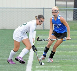 In high school girls' field hockey action, Camden Catholic defeated visiting Paul VI, 1-0, in Cherry Hill on Sept. 25. Above, opposing players vie for the ball. Photo by Alan M. Dumoff, more photos http://ccdphotolibrary.smugmug.com