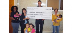 Grand Knight Louis DiLoreto presents a check for $1,200 from Mater Ecclesiae in Berlin to staff, mothers and babies at Good Counsel Homes/South Jersey. The donation was raised by parishioners in a fundraising campaign sponsored by the Knights of Columbus Council 12833. Good Counsel, which is located in Riverside, N.J., is a home for pregnant and parenting homeless mothers and their children. Good Counsel's annual banquet will take place on Sunday, Oct. 26, at Lucien's in Berlin. For reservations or information, contact Mary Ann Lorimer at 215-989-0021 or lorimerma@aol.com.