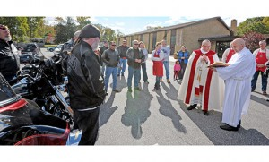 Father Chris Mann, parochial vicar, leads the Blessing of the Motorcycles outside St. Margaret Church, Infant Jesus Parish, Woodbury Heights on the morning of Sunday, Oct. 19. Photo by Alan M. Dumoff