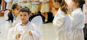 Dressed as angels, students of Guardian Angels Regional School, Gibbstown, are pictured during a school Mass in St. Michael Church, Oct. 2, the feast of the Guardian Angels. The Mass honored both the Guardian Angels and St. Francis of Assisi, whose feast day was Oct. 4. Photo by Alan M. Dumoff, http://ccdphotolibrary.smugmug.com