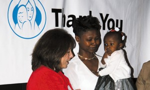 Niketa Burke and her daughter are pictured with Joann DiNoia, fundraising coordinator for Good Counsel Home South Jersey. Photo by Mary E. Stadnyk