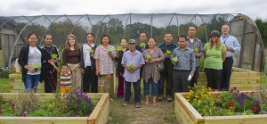 Burmese refugees and others pose for a photo in the Camden County Environmental Park in Gloucester Township during a training day organized by Catholic Charities' refugee services program. For the refugees, gardening is a way of staying connected to the home they left behind, and a significant financial provision for their families now. Photo by Avi Steinhardt