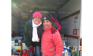 Miriam Tanguay of Long Beach Island, a Catholic Charities employee, is pictured with volunteer Kevin Trotta at a Catholic Charities distribution site immediately after Hurricane Sandy in 2012. Both Tanguay and Trotta were displaced by the storm.