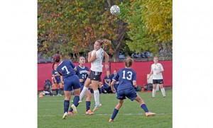 In high school girls' soccer, visiting Holy Spirit (Absecon) defeated St. Joseph in Hammonton, by a score of 4-3. Above, a St. Joseph player goes up for a header amidst Holy Spirit defenders. Photo by Alan M. Dumoff