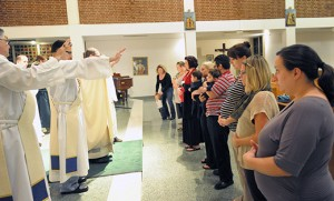 Clergy bless expectant mothers and new parents at the Mass in honor of St. Gerard Majella, patron saint of expectant mothers, Oct. 16 at St. Bridget Church, Glassboro. Photo by Alan M. Dumoff, http://ccdphotolibrary.smugmug.com