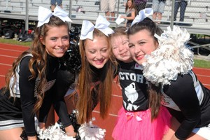 On Sept. 27, Bishop Eustace Preparatory School in Pennsauken held Victory Day for special needs students, as football players, Pep Band members and cheerleaders rooted them on during their activity drill on the school's football field. Above, Madelyn DeLuca is a cheerleader for the day, with Gina D'Antonio, Gabrielle Sheehan and Elisabeth Reilly. Photos by Maria D'Antonio