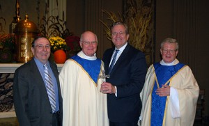 Msgr. John H. Burton, vicar general, (far right), stands with the three individuals who were honored with the St. Luke Award at the annual White Mass for Heathcare Workers, celebrated Oct. 19 in the chapel of Our Lady of Lourdes Medical Center, Camden. Pictured from left are social worker David Haggerty of St. Joseph the Worker Parish, Haddon Township; Father James J. Durkin, retried chaplain at St. Mary's Catholic Home, Cherry Hill; and Joseph W. Devine, president and CEO of Kennedy Health Systems. The St. Luke Awards are presented each year to individuals for dedication and service in the field of health care. Photo James A. McBride