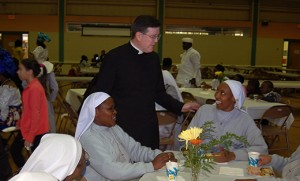 Father George Seiter, Camden Diocesan director of the Propagation of the Faith and director of Diocesan Missions, talks with several Sisters of Mary Immaculate of Nyeri, Kenya, who work at Bishop McCarthy Residence, Vineland, following Mass Oct. 19, World Mission Sunday, at St. Pius Church, Holy Eucharist Parish, Cherry Hill. Left, Father Seiter stands with Father Joachim Ifezuo Oforchukwu, C.S.Sp. Photos by James A. McBride