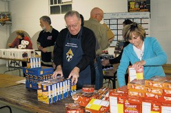 Bishop joins in packing Thanksgiving baskets
