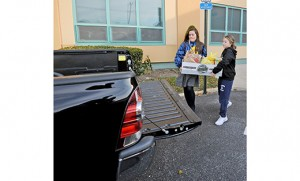 Students carry boxes of donated food to trucks at St. Mary School, Williamstown, and St. Joseph Regional School, Somers Point. The schools were among many schools and parishes in the Camden Diocese to hold a Thanksgiving food drives. Above photo by Photo by Alan M. Dumoff