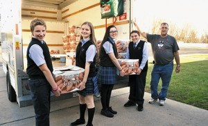 Students carry boxes of donated food to trucks at St. Mary School, Williamstown, and St. Joseph Regional School, Somers Point. The schools were among many schools and parishes in the Camden Diocese to hold a Thanksgiving food drives. Students carry boxes of donated food to trucks at St. Mary School, Williamstown, and St. Joseph Regional School, Somers Point. The schools were among many schools and parishes in the Camden Diocese to hold a Thanksgiving food drives. Top photo by Photo by Alan M. Dumoff