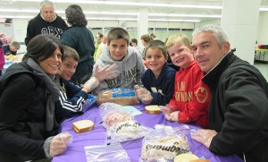 Laura and Tim Sheehan, and their sons sons Matthew, Timothy, Joseph and Thomas, make sandwiches for the Cathedral Kitchen at Blessed Teresa of Calcutta Parish in Collingswood on Oct. 23. The family was participating in the first of a series of events at the parish called the Matthew 25 Project, an effort to put into practice the teachings of Christ to feed the hungry and give drink to the thirsty, welcome the stranger, clothe the naked, care for the sick and visit the imprisoned. Photo by Joanna Gardner
