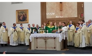 Bishop Dennis Sullivan celebrates Mass with priests of the Camden Diocese and their parents Nov. 16 at Our Lady of Peace Parish, Williamstown. There were 43 parents present and 18 priests.