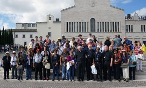 Pilgrims from the Camden Diocese led by Father Robert Hughes, vicar general of the diocese, and other pilgrims pose for a photo in San Giovanni Rotondo, the Italian town where St. Padre Pio lived and ministered for decades.