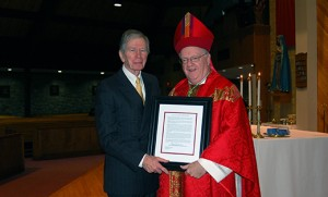 Bishop Dennis Sullivan presents Joseph H. Kenney with the St. Thomas More Society Award at the Red Mass, celebrated Nov. 19 at the Church of St. Margaret in Woodbury Heights. The award is given annually to a member of the legal profession who exemplifies the principles of Thomas More, the 16th century English lawyer and saint. Kenney is a retired trial lawyer. He served as president of The Association of the Federal Bar of New Jersey, the Camden County Bar Association, and the New Jersey State Bar Foundation.