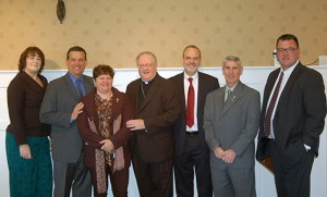 At the Catholic Business Network of South Jersey's monthly breakfast on Nov. 14 at Woodcrest Country Club, Bishop Dennis Sullivan spoke to area businessmen and women. Above, Bishop Sullivan with the Executive Board: Sheila McGirl, founder and vice-president, of the Diocese of Camden; Jim Turpin, president, of American Prosperity Group; Denis Lathrop, treasurer, of Wells Fargo; Gary Zimak, chaplain, author and speaker; Jeff Morris, founding member and chairman of membership, of Morris Graphics; and Barry Phillips, founder and president of the Catholic Business Network of Greater Philadelphia, of Devon Financial. Photo by James A. McBride