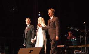 Phil Coulter, Geraldine Branagan and Andy Cooney take a bow on the stage of the TD Banks Arts Centre Dec. 6. Proceeds from the event, Celtic Twilight Christmas, will benefit the South Jersey Scholarship Fund. Photos by James A. McBride Bishop Dennis Sullivan sings for  the crowd of 1,800.
