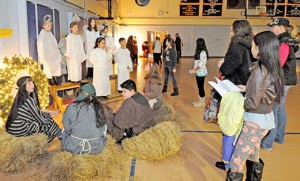 Students participate in a living Nativity at St. Joseph Regional School, Somers Point, on Dec. 7. Below, students of St. Teresa Regional School, Runnemede, load a truck with donations from their Christmas toy drive. Photo by Alan M. Dumoff, more photos, http://ccdphotolibrary.smugmug.com Santa, played by Tom Buono, visits with sisters Brynn and Kiera Cunningham at the Christmas Bazaar at Bishop McHugh Regional School, Cape May Court House, on Nov. 15.