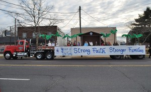 "St. Mary School, Vineland, recently entered a float in the Annual Vineland Christmas Parade and took home two second place trophies in the categories of ""School"" and ""Church Organizations."" St. Mary School chose the Diocese of Camden's ""Year of the Family: Strong Faith — Stronger Families"" theme as the message they wanted to send to all parade onlookers."