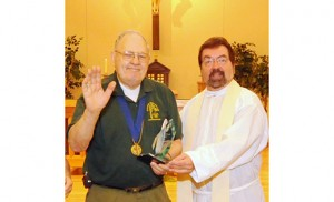 Andy Wager accepts the Bishop's Scouter Award from Father Paul D. Harte in 2009. He was the first recipient of the award.