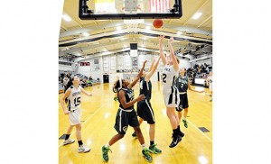 Visiting Camden Catholic (Cherry Hill) defeated Bishop Eustace (Pennsauken) 67-40 on Jan. 13, in high school girl's basketball. Above, the Crusaders' Elizabeth Radley goes up for 2. Photo by Alan M. Dumoff, http://ccdphotolibrary.smugmug.com