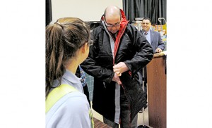 Pastor Rob Weinstein of Bridgeton tries on a donated coat. Photo by Alan M. Dumoff