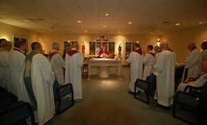 Bishop Dennis Sullivan celebrates Mass at Sacred Heart Residence for Priests, Cherry Hill, on Dec. 16. Some 20 retired priests of the Camden Diocese live there. Photo by James A. McBride