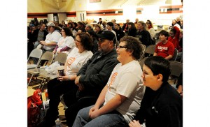 Andrew Zappley, wearing a white T-shirt, watches himself compete on the television cooking show MasterChef Junior on Jan. 6. Andrew's school, Holy Trinity in Westville Grove, invited the school community to view the show in the gym. Photo by Alan M. Dumoff
