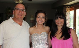 Brianna Ranzino is pictured with her parents, Lisa and Frank, before her high school senior prom (above), and several years before with her mother on one of many flights to Boston for medical treatment (below). The organization, Angel Flight East, provides free air transportation to medical treatment in distant cities.