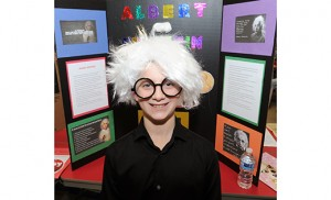 "St. Michael the Archangel Regional School in Clayton presented ""A Night At The Wax Museum"" on Jan. 28, with students in grades 5-8 dressing as historic ""wax"" figures and providing visitors with information about their characters and achievements. Above, Albert Einstein (fifth grader Vincent Masci) wigs out in the name of science, while Blessed Mother Teresa (sixth grader Faith Rosa) tells her story. Photo by Alan M. Dumoff, http://ccdphotolibrary.smugmug.com"