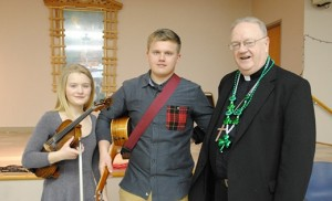 On March 13, Bishop Dennis Sullivan lent his voice to the Irish music of Haley and Dylan Richardson during a surprise early birthday present for the Camden leader, whose birthday is March 17, St. Patrick's Day. The birthday celebration was part of a diocesan Lenten Day of Recollection, held at Holy Family Parish, Sewell. Photo by Maria D'Antonio