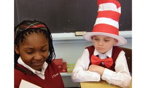 "Sixth grader Suzy Ndandji reads to second grader Harry Moore on March 2, the birthday of Dr. Seuss, at St. Teresa School, Runnemede. Below, Eddie Davis of Literock 96.9 WFPG begins his Read Across South Jersey tour by reading ""The Cat in the Hat"" at St. Vincent de Paul Regional School, Mays Landing."